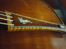 Tailpiece of a stradivarius violin. Got to love the figuring on the wood and the inlay. Bellissimo!