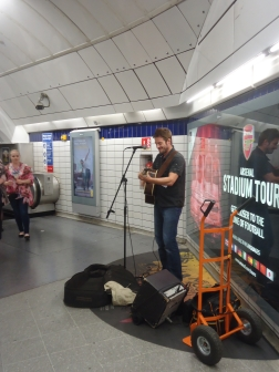 A typical scene in a tube station. Buskers are given designated areas to perform in tube stations and require a permit issued The London Underground. To busk in nicer places like Kensington Garden, even an audition is required!