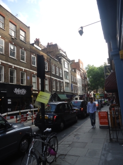 """Though it's hard to tell, this street at the edge of London's Chinatown is lined with music shops ranging from pianos to 'ukuleles. Had a """"field hour"""" before everything closed."""