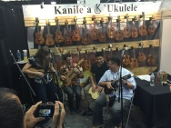Craig Chee and Sarah Maisel jamming at the Kanile'a booth with Milo Fultz and Merlin Showalter