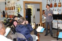 Milo Fultz teaching an 'ukulele bass workshop